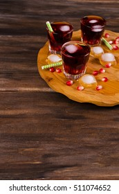 Transparent drink of pomegranate on a dark background. Selective focus.