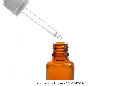 transparent drugstore vial of orange color