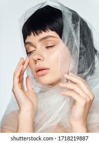 Transparent fabric Charming lady closeup portrait