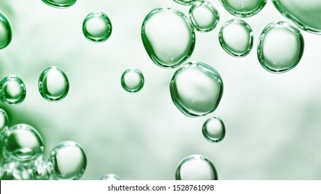 transparent gas bubbles on water surface. Worms-eye low angle with crystal bubbles in purified water on green background. cosmetic backdrop with copy space