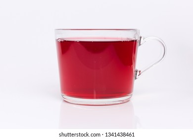Transparent glass cup with Hibiscus tea isolated on a white background