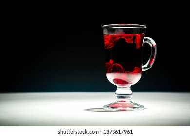 Transparent glass Cup with hot red tea from hibiscus or hibiscus