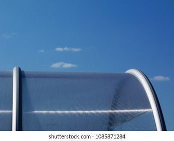 transparent glass dome cover under blue sky and little white cluds