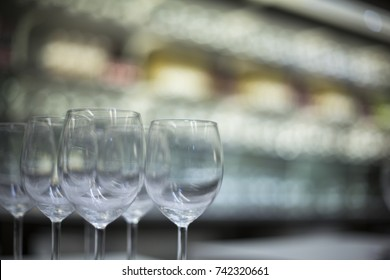 transparent glass goblets and wine glasses on the store shelf and soft focus