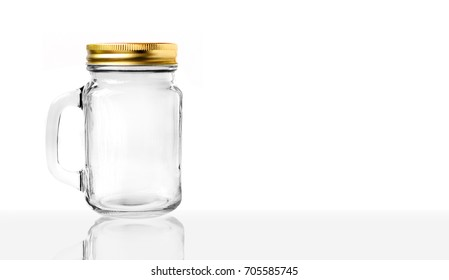 Transparent Glass with handle and gold cover on white background