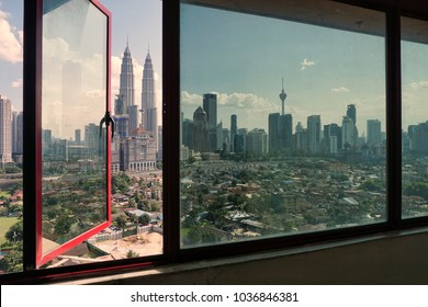 Transparent glass windows look like views of Kuala Lumpur city during sunny days.