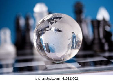 Transparent globe on chess board