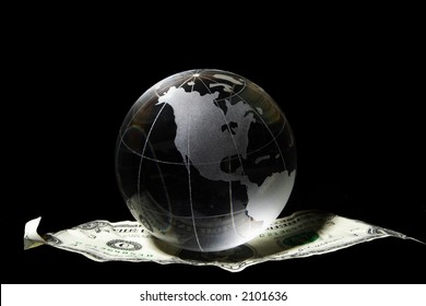 Transparent globe on a US dollar floating in black