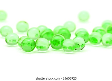Transparent green capsules isolated on white