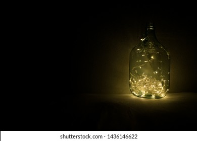 Transparent jar with lights from led at the dark room. Festive decorations, copy space
