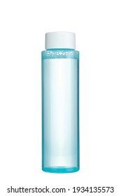 Transparent micellar water. Makeup cleanser for face skin. Plastic Bottle with blue liquid inside, isolated on white background.