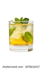 Transparent one-color cocktail in a low glass with crushed ice frappe with mint leaves with melon, pear, apple taste. Side view Isolated white background. Drink for the menu restaurant, bar, cafe