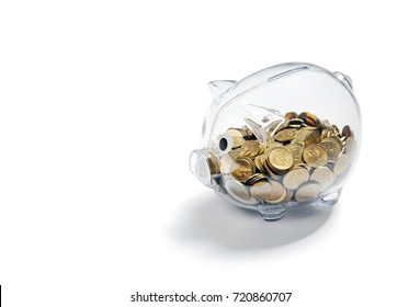 Transparent piggy bank with coins