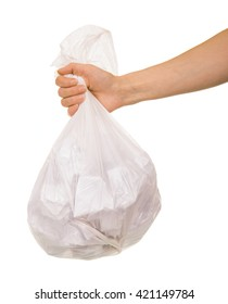Transparent plastic bag with paper waste in a female hand isolated on white background.