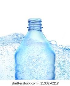 Transparent plastic blue color bottle  against water bubbles background.