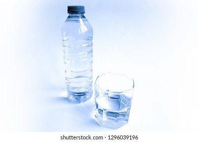 Transparent plastic bottle with glass of water on a white background..Water concept for health