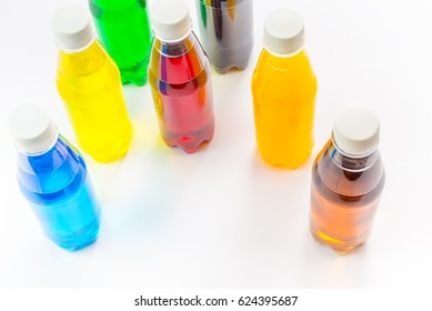 transparent plastic bottles with colorful natural juices