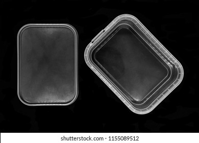 Transparent plastic box bottom separated from lid and isolated on black background surface