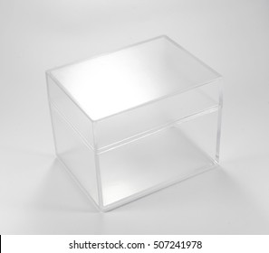 Transparent plastic box on white background