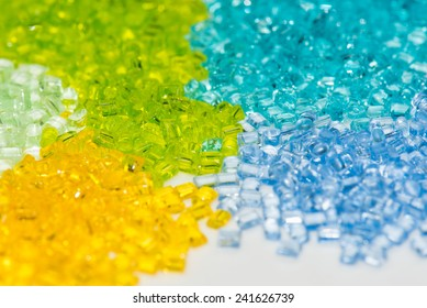 transparent polymer pellets in lab on white table