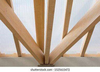 transparent roof of the gazebo on wooden timber supports