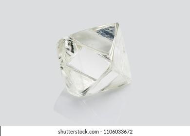 Transparent rough diamond isolated on white background.