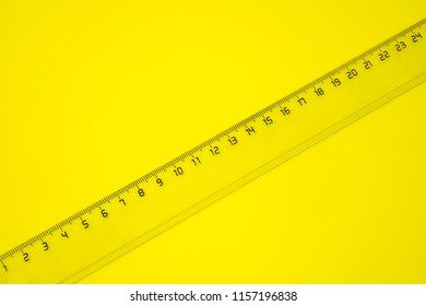 Transparent ruler on yellow background.