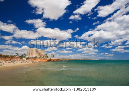 Transparent sea, summer landscape, travel to Spain, hotel on the beach