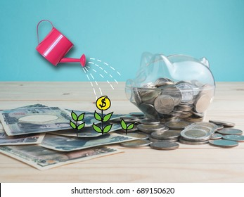 transparent see through piggy bank filled with coins on wood background.Saving investment colorful concept.