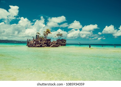 Transparent shallow water. Travel to Philippines. Summer luxury vacation. Boracay paradise island. White beach. Seaview. Tourism concept. Willy's rock. Religion, tourist landmark. Place for text