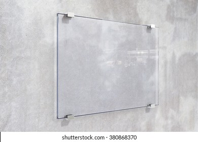 Transparent signboard on concrete wall, mock up
