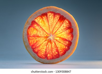 Transparent slice of grapefruit. See another picture from the same series.