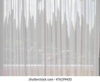 Transparent Soft White Fabric Curtain On Grass Door Of Modern Building, See  Through Balcony And