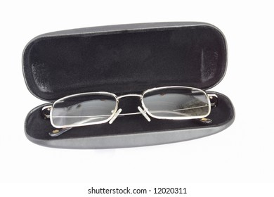 transparent spectacles in black case on white background