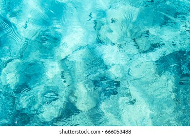 Transparent turquoise sea water, natural background. Emerald Coast, Sardinia, Italt. - Shutterstock ID 666053488