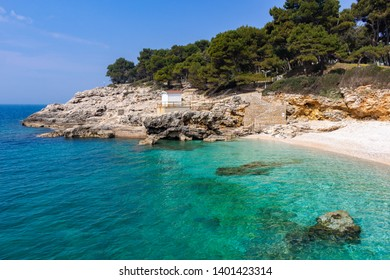 Transparent turquoise waters and white rocks at Havajski beach, one of the best beaches in Pula, Croatia