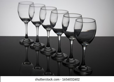 Transparent Wine Glass Cups in a row.