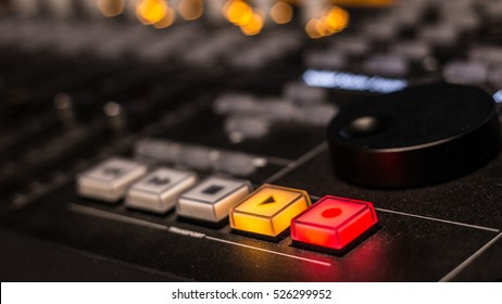 Transport Buttons in Recording / Mixing Console in low light condition studio with bokeh and shallow depth of field.