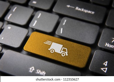 Transport delivery key with truck icon on laptop keyboard. Included clipping path, so you can easily edit it.