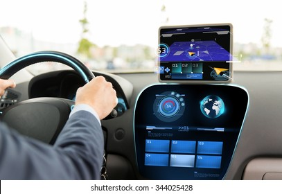transport, destination, modern technology and people concept - close up of man driving car with navigation system on tablet pc computer