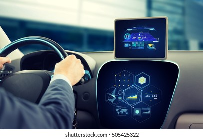 transport, destination, modern technology and people concept - close up of man driving car with navigation system on tablet pc computer and charts