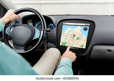 transport, destination, navigation, modern technology and people concept - close up of man driving car with gps navigator map on board computer screen