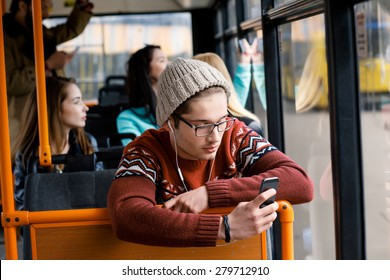transport. people in the bus. she wondered in transport. man rides a bus, listening to music