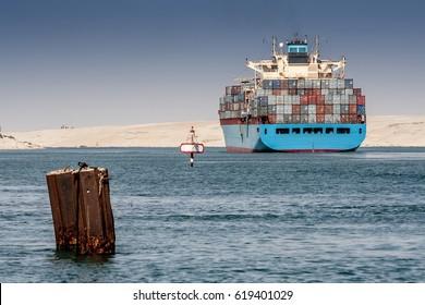 Transport ship sails through Suez channel, Ismailia, Egypt