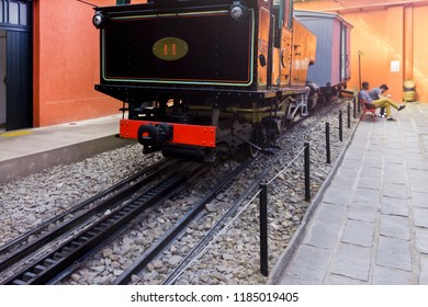 Transport - Steam train station with men sitting in the background