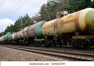 Transport tank car LNG by rail, gas - oil products. LPG transport propane. The fuel train, rolling stock with petrochemical tank cars. Liquefied natural gas export