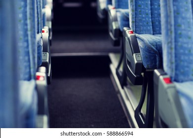 transport, tourism, road trip and equipment concept - travel bus interior and seats