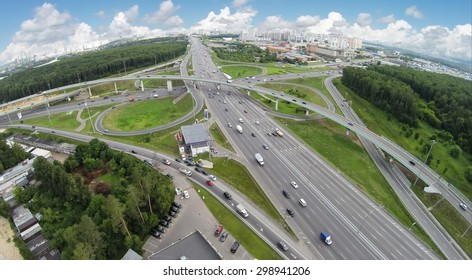 Transport traffic on Novorizhskaja flyover and Moscow ring road at summer day. Aerial view. Photo with noise from action camera.