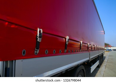 Transport and unloading. Semi-trailer with covered tarpaulin before unloading.