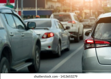 Transportation of cars on the road. Open light break waiting to release traffic signals in the intersection. Heading to travel or work. On the asphalt road. City for background.